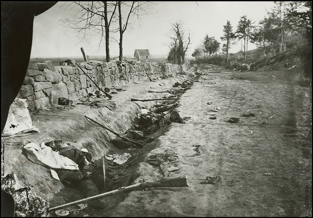 Confederate dead behind the stone wall of Marye's Heights, Fredericksburg, Virginia, 1863