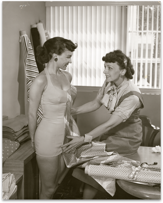 Rose Marie working on the design for a swim suit with a live model