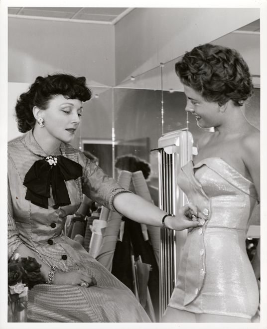 Rose Marie talking to a model about the gospel