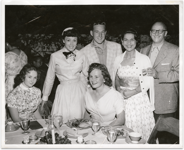Rose Marie, her children and guests enjoying a California garden party in the backyard of Jack and Nina Kessler—two of the earliest investors in Rose Marie's California business