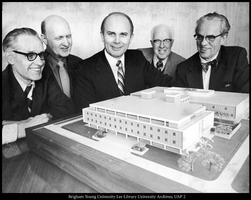 University administrators examine a model of the addition to the Harold B. Lee Library, March 1974